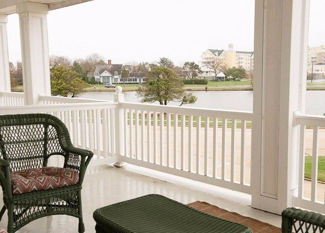 chair property porch building home product cottage Balcony outdoor structure baluster Villa Deck