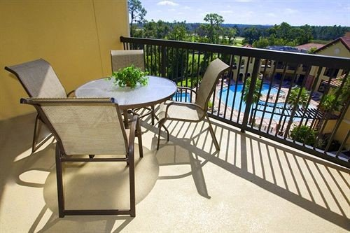 chair property building Balcony Villa outdoor structure cottage condominium porch Deck