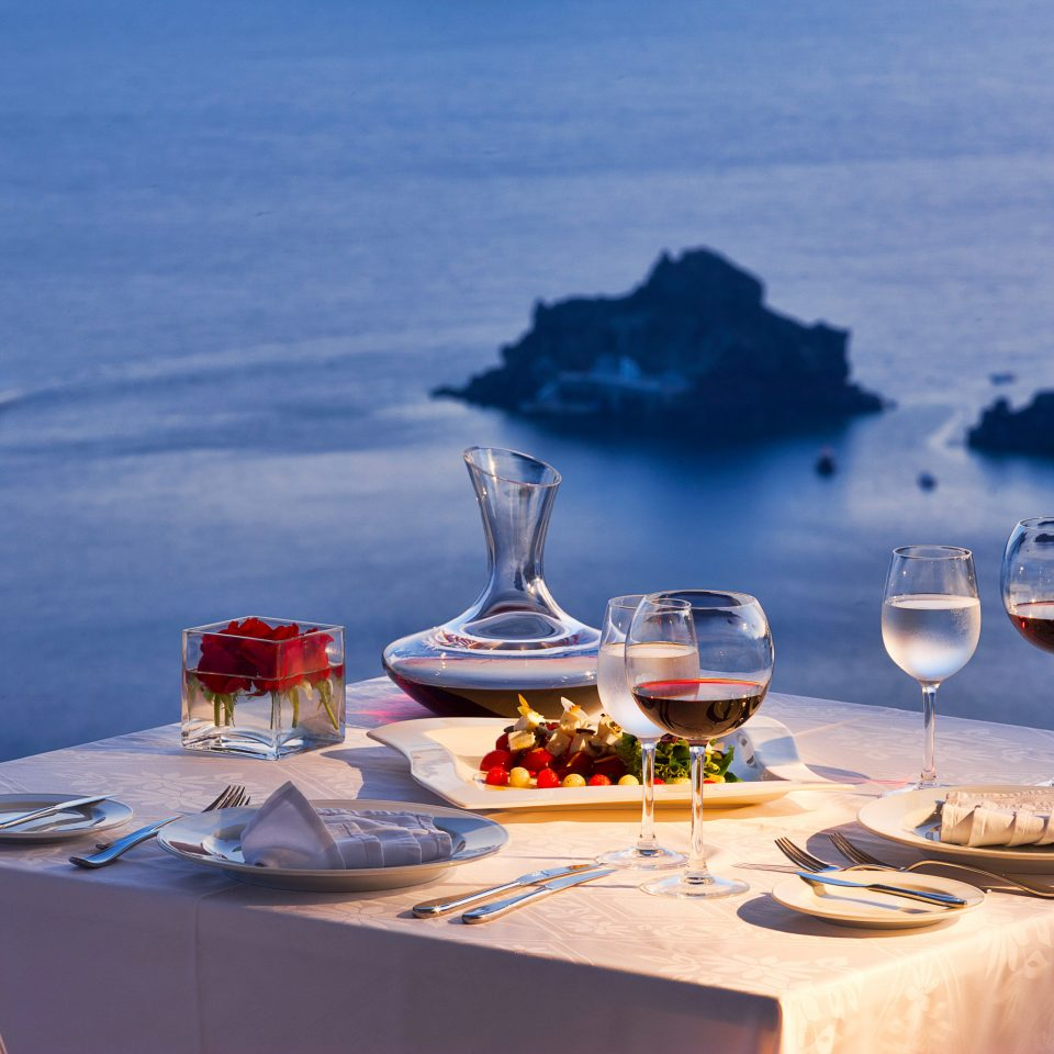 Balcony Dining Drink Eat Elegant Historic Honeymoon Romance Romantic Scenic views Sunset Waterfront blue restaurant Sea