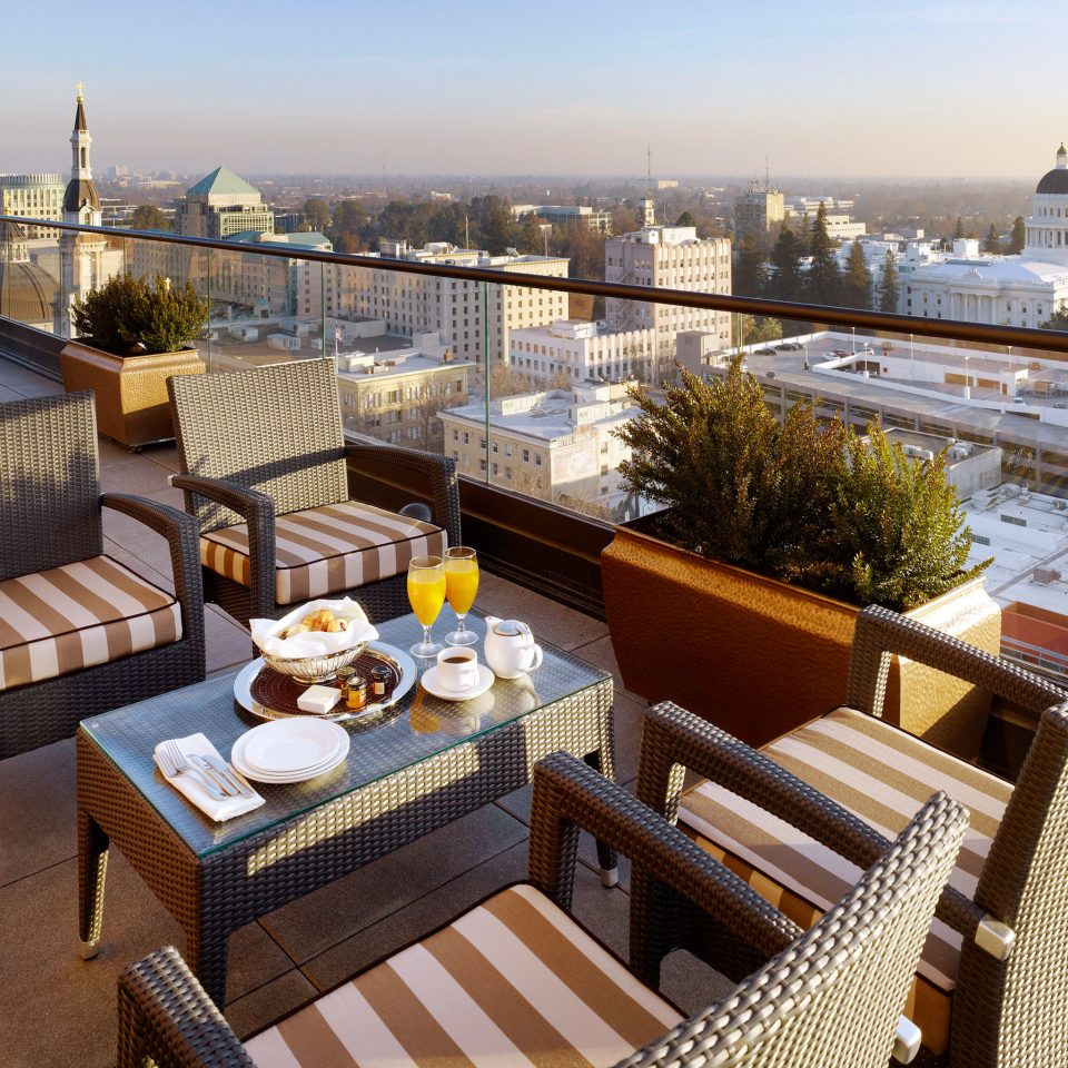 Dining Drink Eat Hip Historic Influencers + Tastemakers Lounge Modern Rooftop Scenic views sky property condominium Balcony outdoor structure overlooking