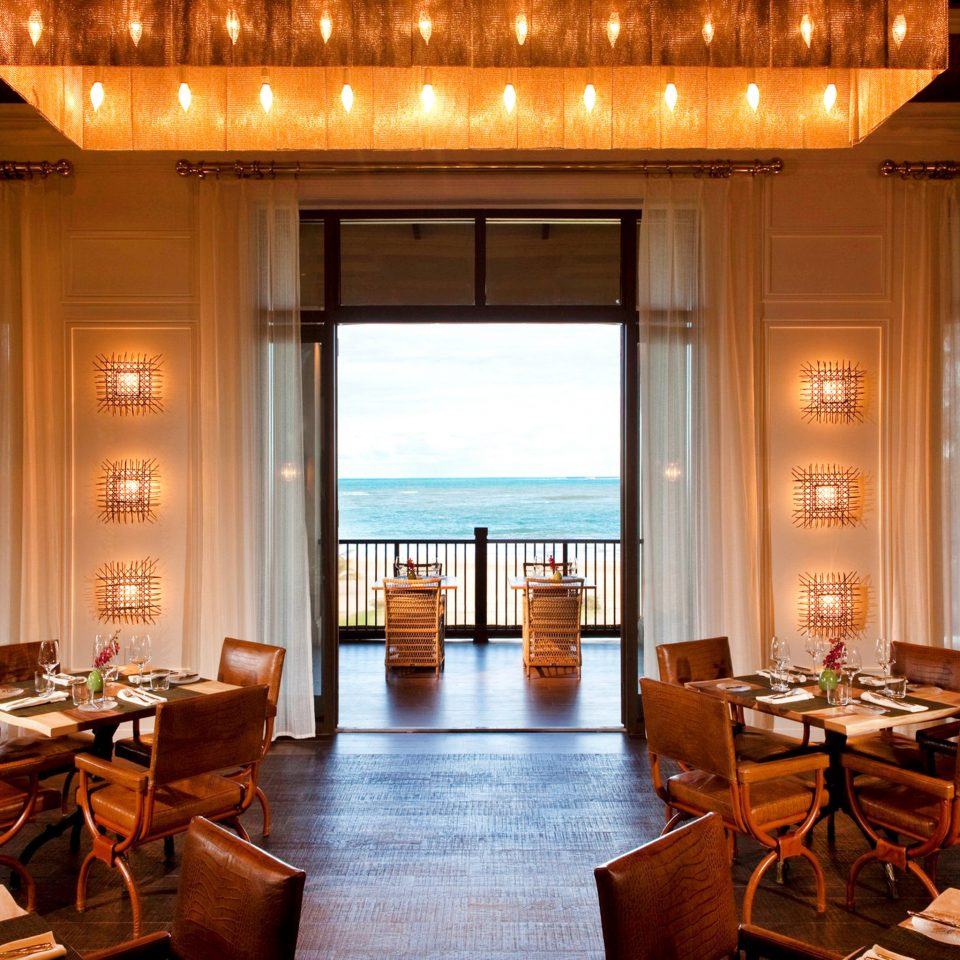 Balcony Dining Drink Eat Hotels Luxury Resort Scenic views Trip Ideas chair property Lobby home living room restaurant mansion dining table