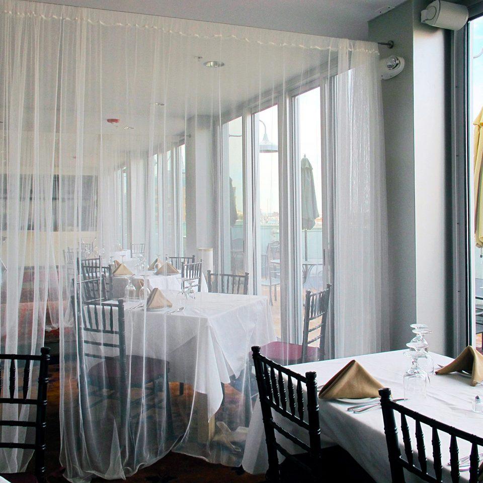 Balcony Dining Drink Eat Inn Patio Terrace property chair curtain home window treatment textile living room