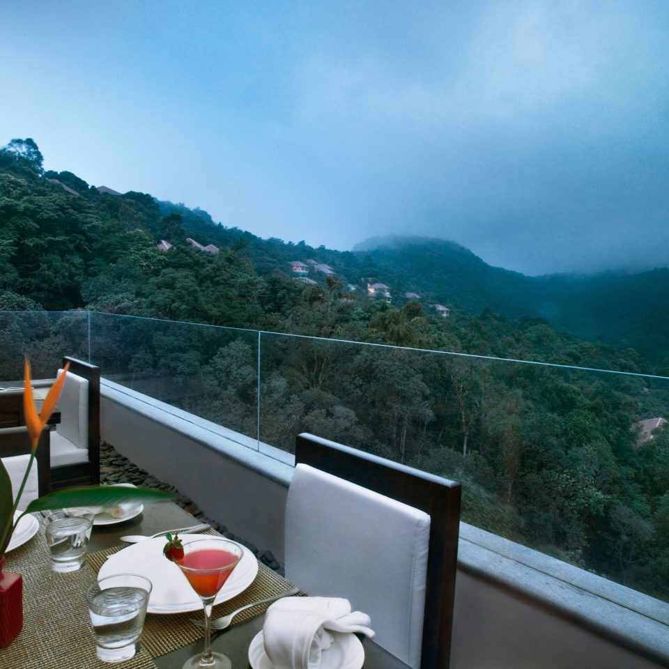 Balcony Dining Drink Eat Elegant Forest Hotels Luxury Patio Scenic views Terrace mountain travel Sea mountain range