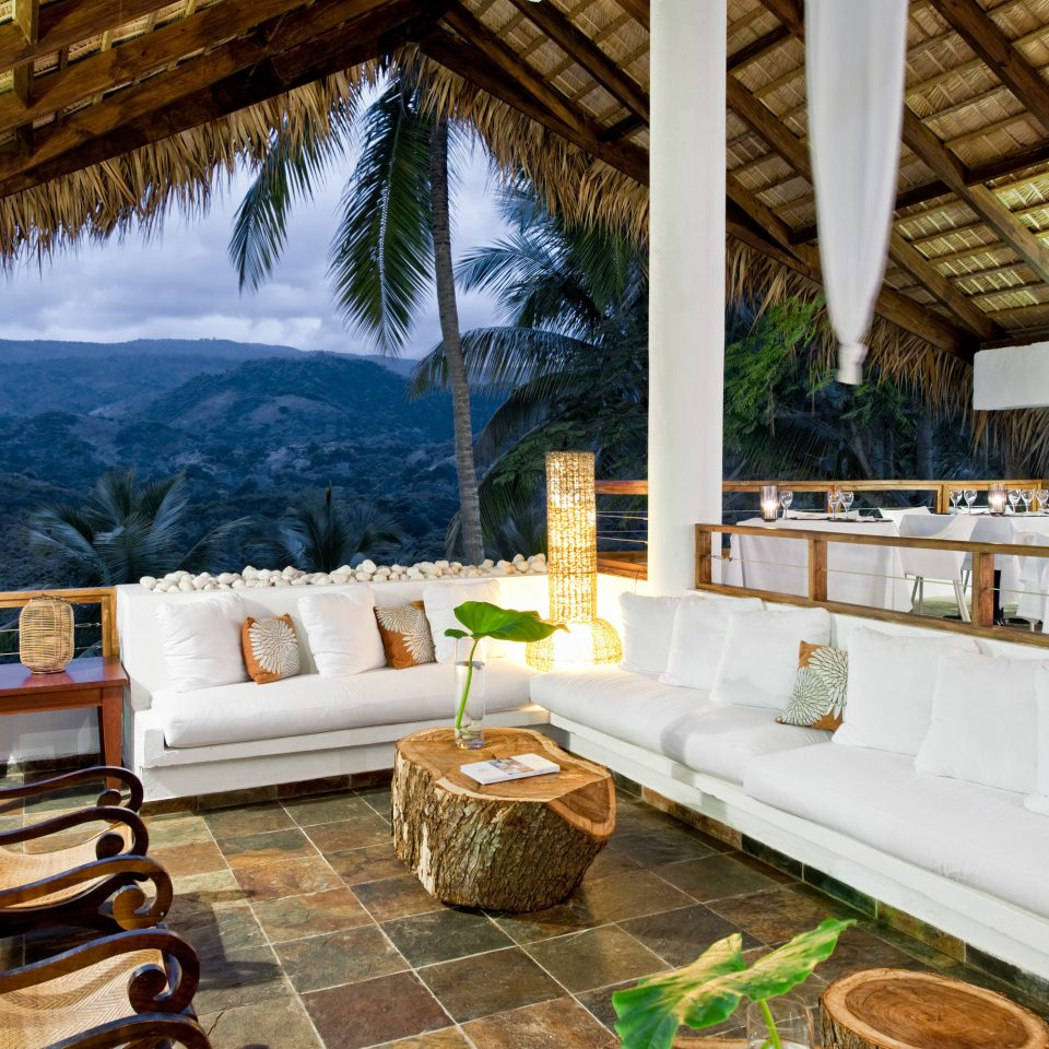 Balcony Dining Drink Eat Eco Lodge Lounge Scenic views property Resort Villa home mansion living room cottage restaurant log cabin