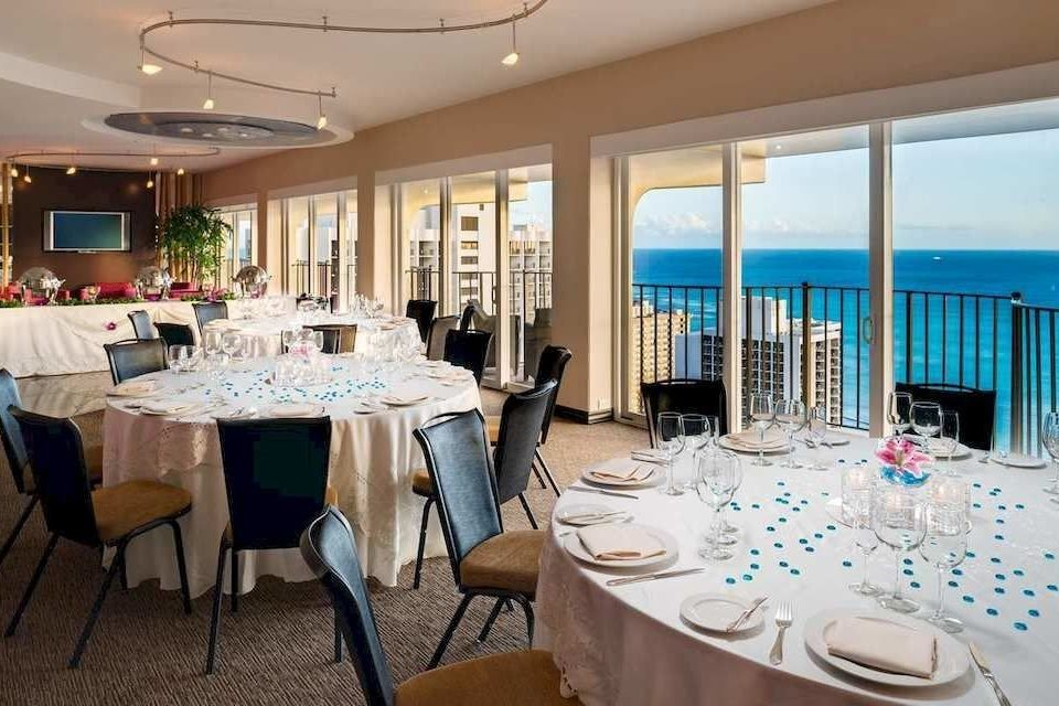 Balcony Dining Drink Eat Resort Scenic views chair function hall restaurant Party Suite banquet overlooking dining table
