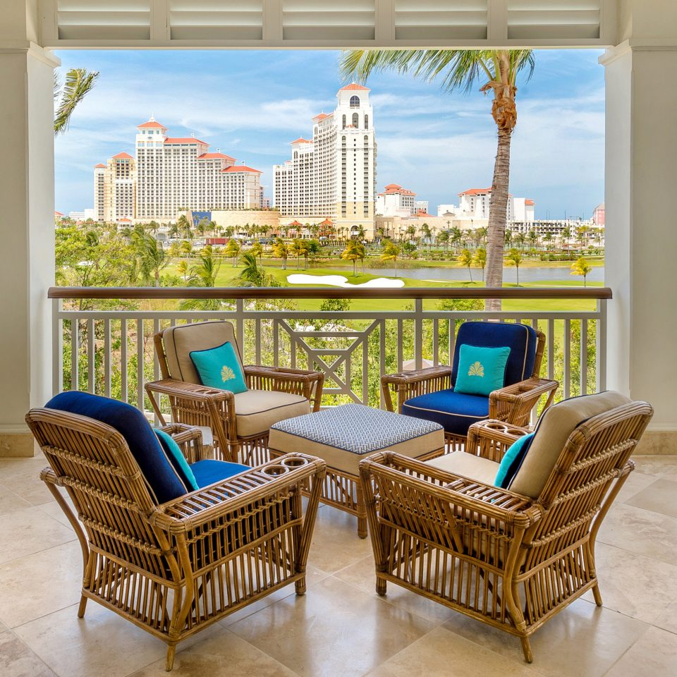 chair property Balcony home outdoor structure Resort Patio condominium Dining penthouse apartment outdoor furniture living room overlooking