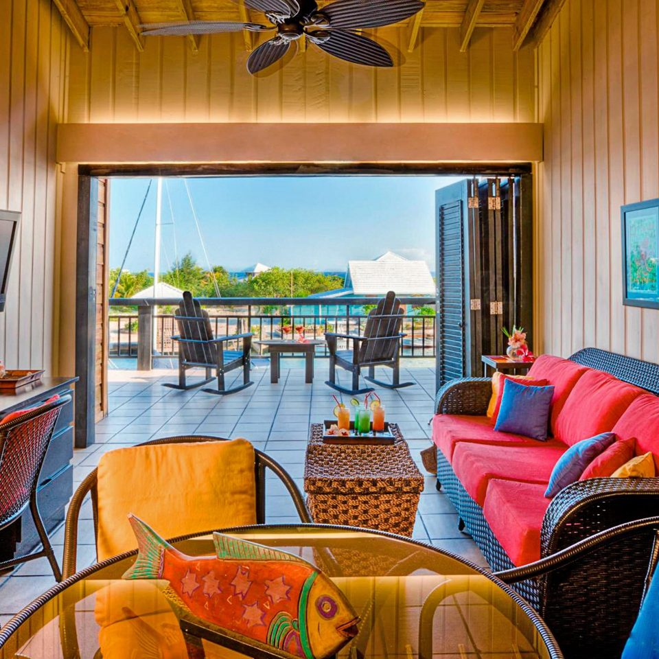 Balcony Eco Family Island Outdoor Activities Waterfront property house Resort living room home Suite cottage Villa colorful leather