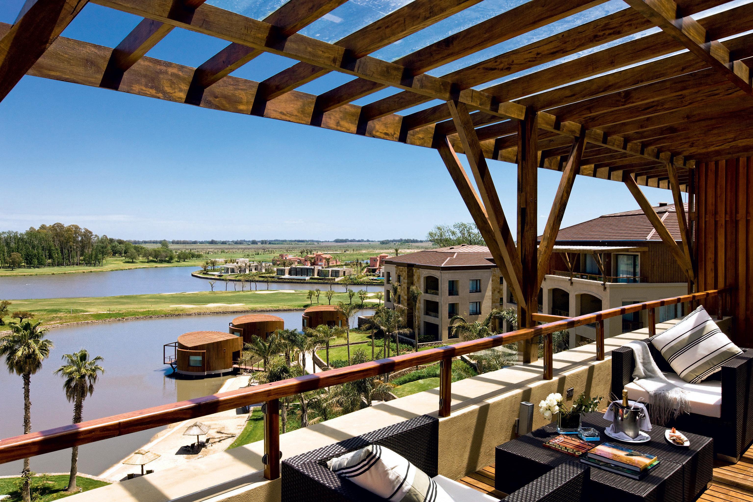Balcony Exterior Grounds Lounge Patio Resort Romantic Terrace Waterfront overlooking