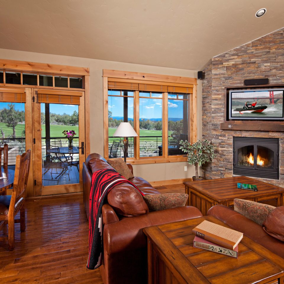 Balcony Fireplace Ranch Rustic Scenic views Suite living room property home house hardwood recreation room cottage