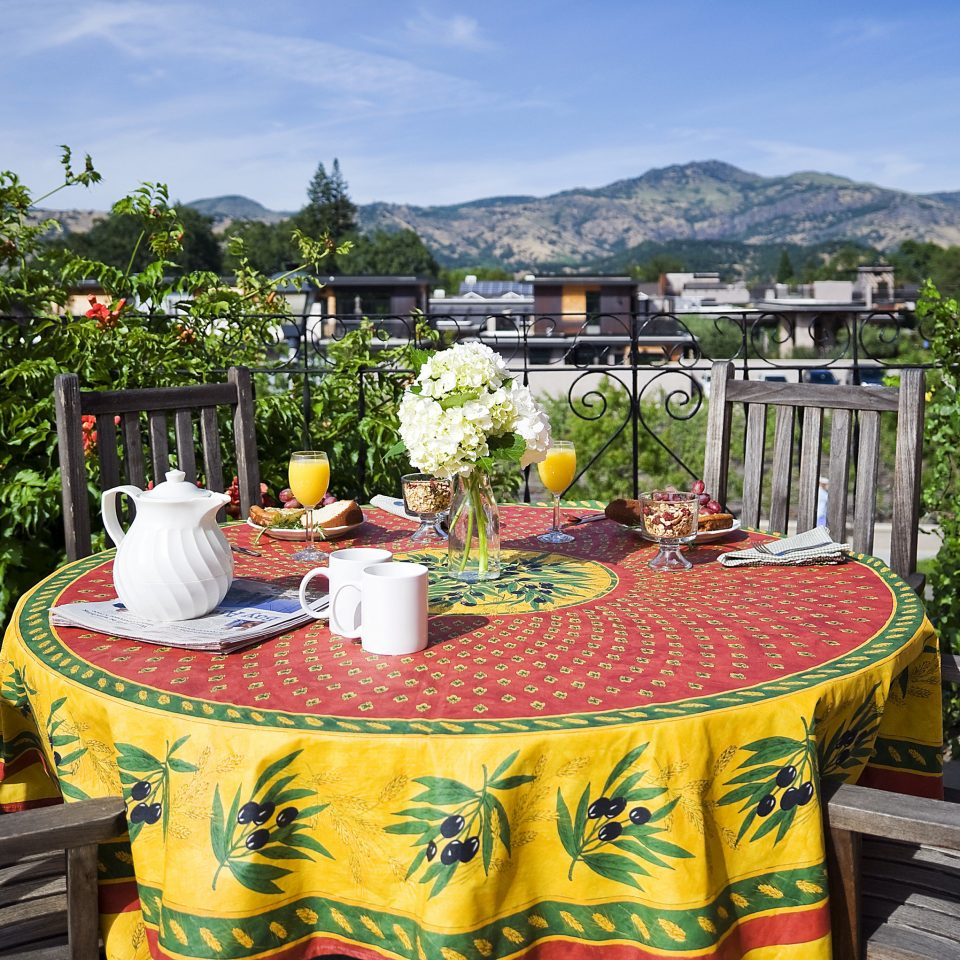 tree property plant Garden outdoor structure flower house leisure Balcony recreation tablecloth colorful