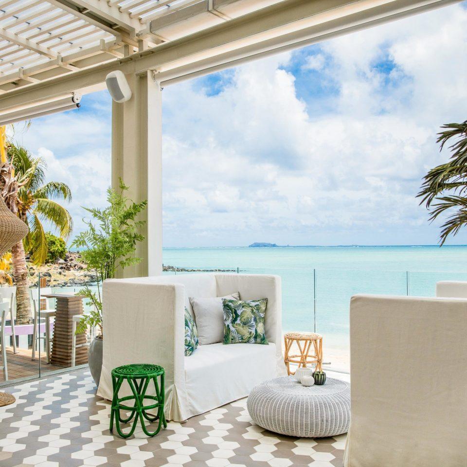 Health + Wellness Hotels Luxury Travel property building Resort home palm tree arecales condominium Balcony Villa penthouse apartment