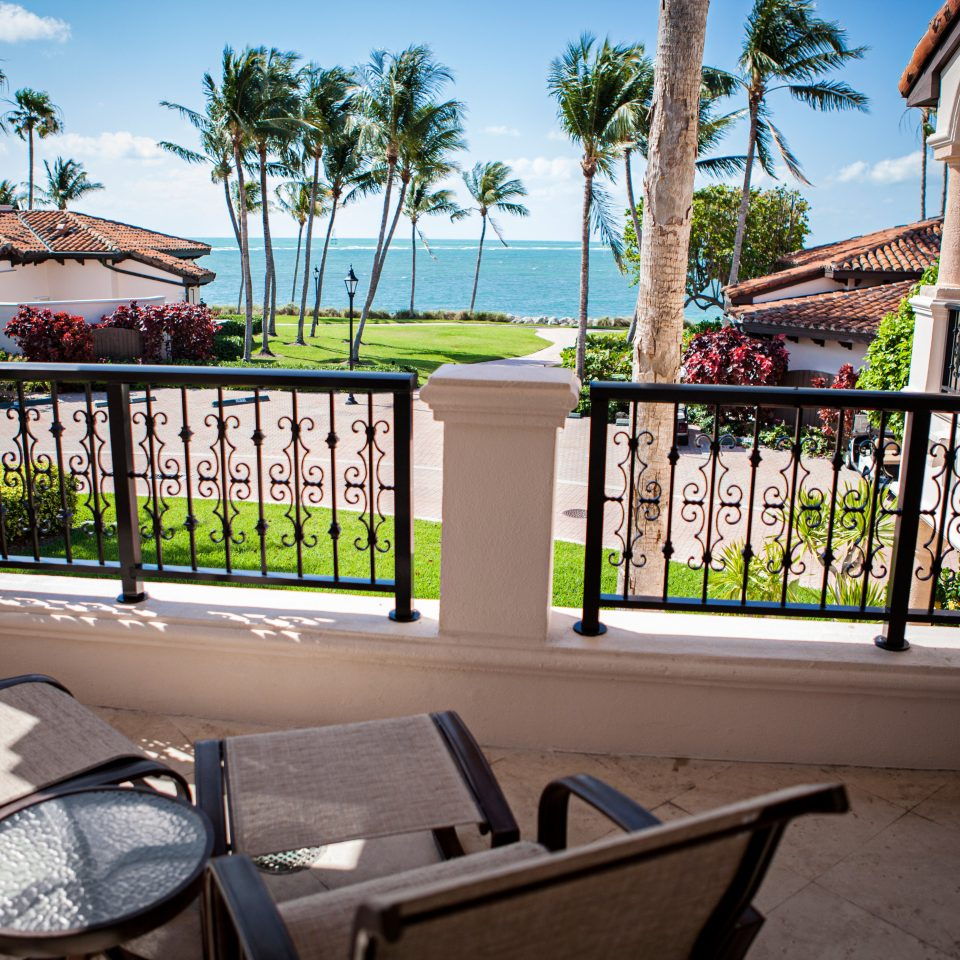 Balcony Lounge Patio Scenic views sky property building home house condominium Resort Villa mansion cottage