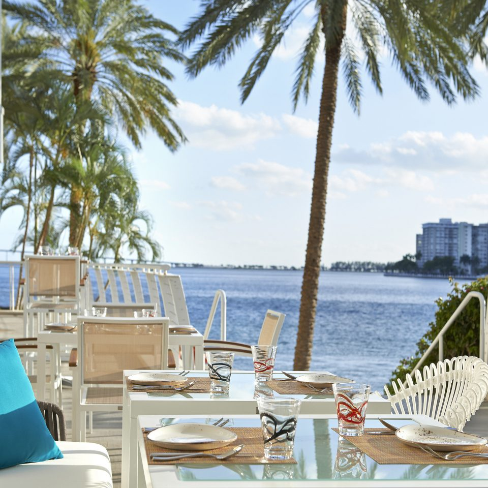 Resort property palm tree arecales restaurant condominium outdoor structure leisure Balcony outdoor furniture penthouse apartment