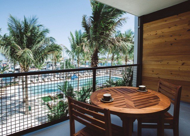 property Resort Balcony condominium palm tree arecales swimming pool penthouse apartment Villa hacienda dining table