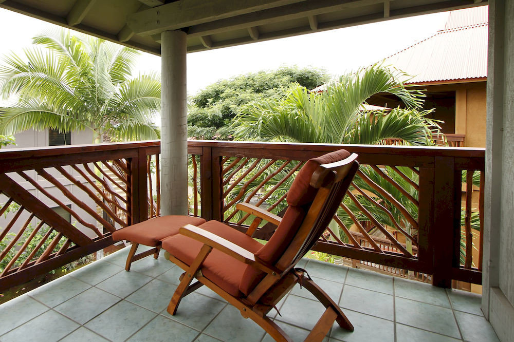 chair building porch property leisure home Villa Resort outdoor structure cottage backyard Balcony living room