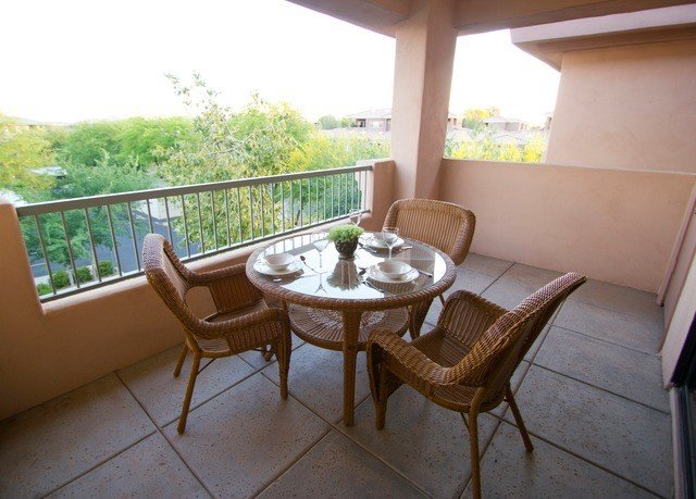 property building Villa cottage home hacienda Resort Balcony condominium porch dining table