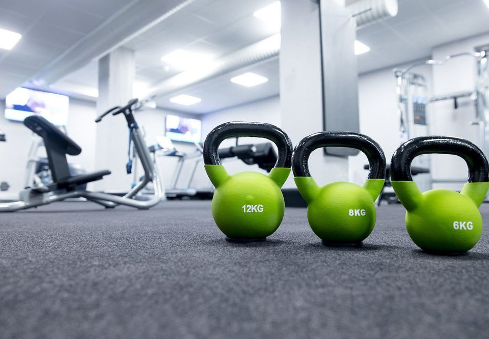green structure sport venue exercise equipment sports equipment black gym wheel kettlebell office ball