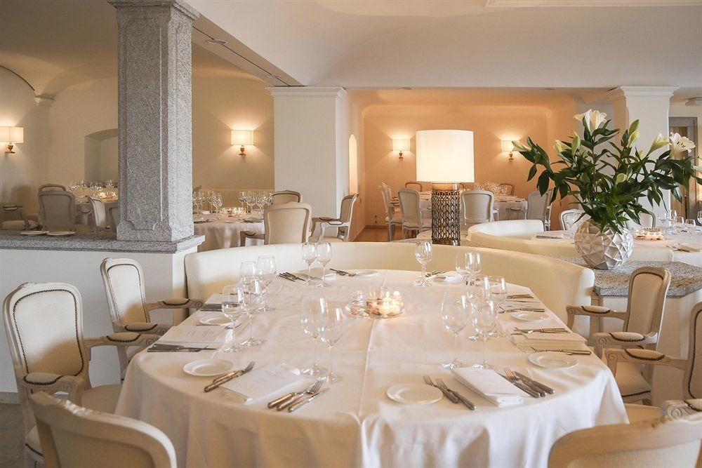 function hall banquet restaurant wedding ceremony white ballroom wedding reception centrepiece dining table