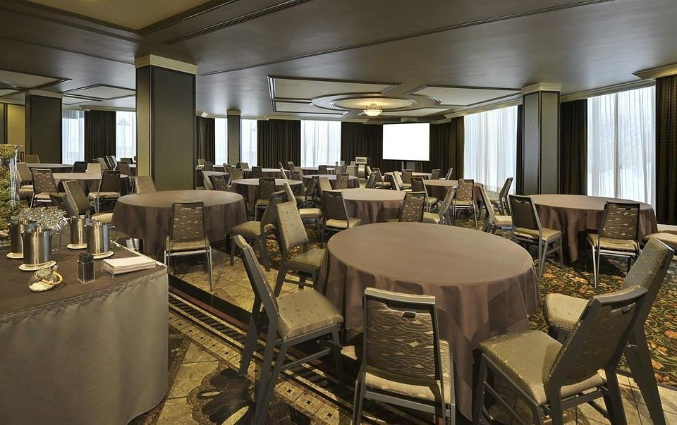 chair restaurant function hall conference hall convention center ballroom dining table
