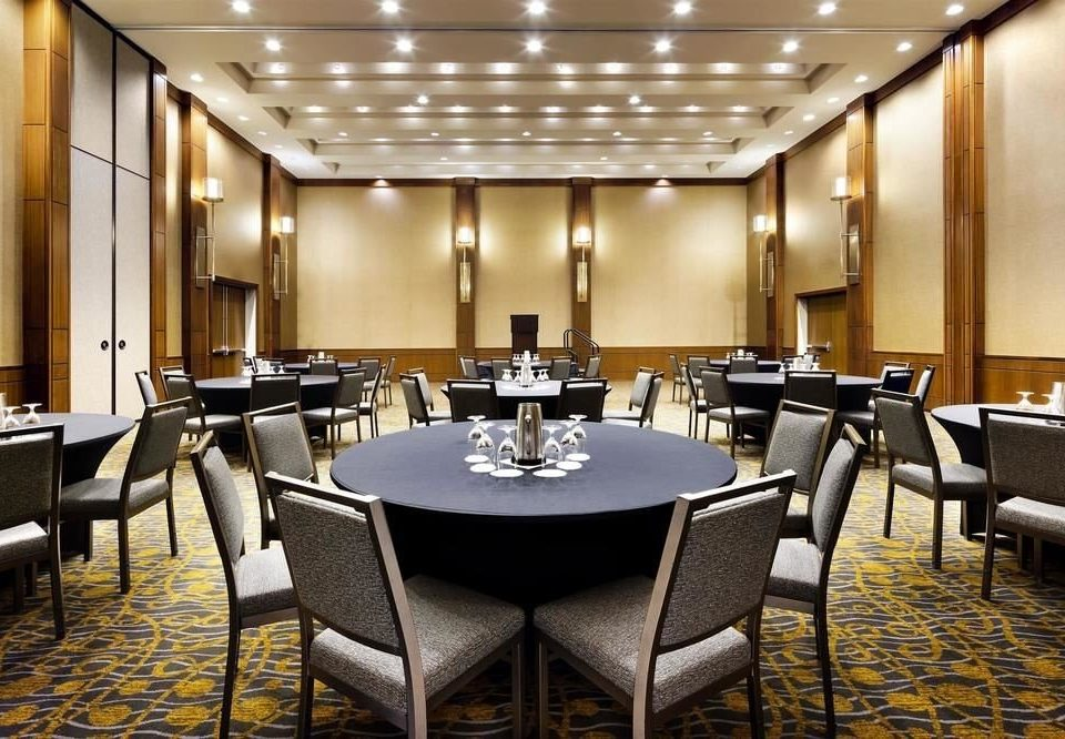 chair conference hall function hall convention center restaurant meeting ballroom dining table