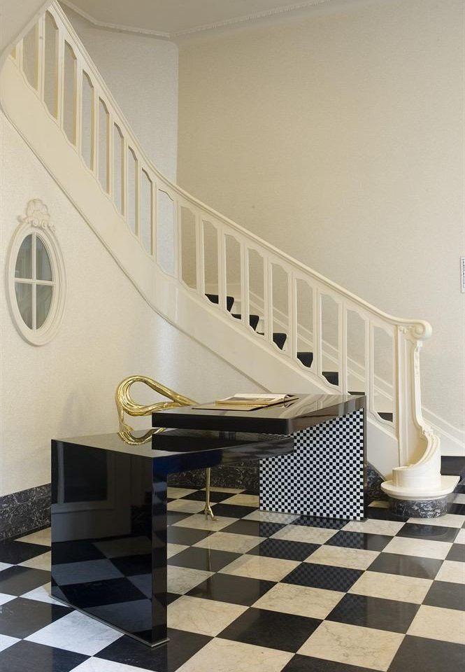 property stairs flooring baluster hardwood handrail black tile home living room wood flooring tiled