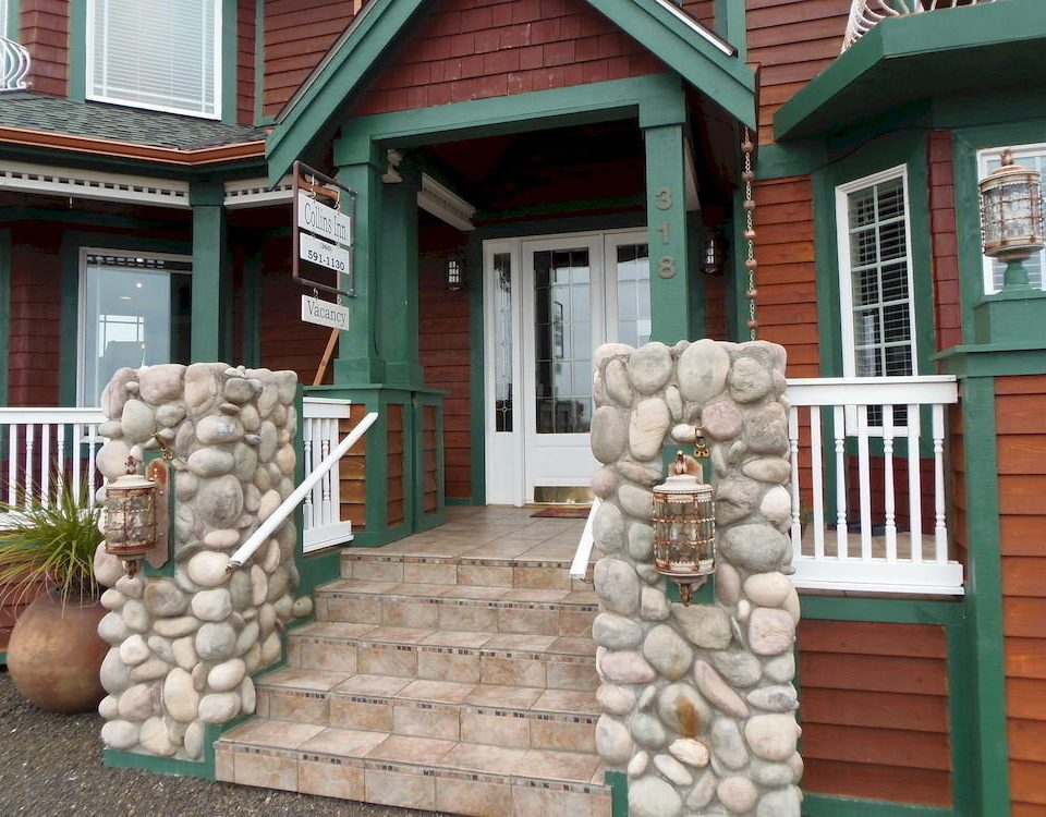 building porch home house baluster outdoor structure mansion cottage siding stone