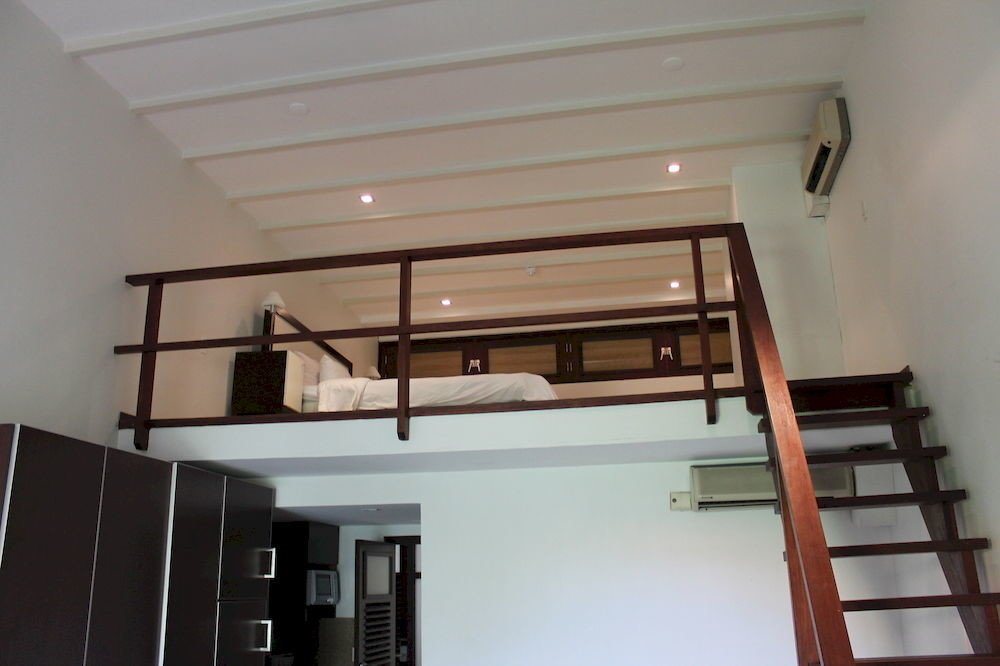 property stairs handrail house home loft daylighting cottage baluster living room