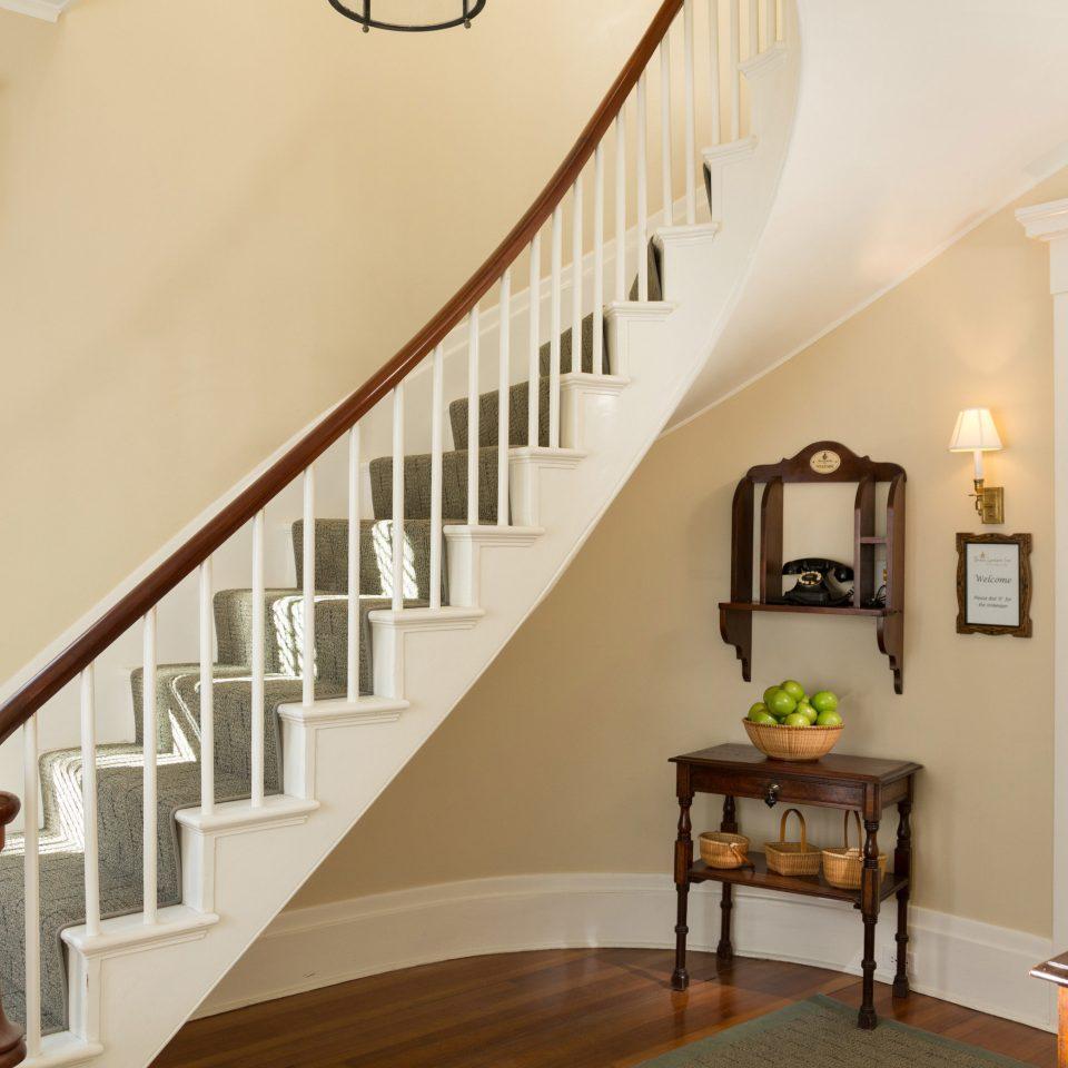 stairs property home hardwood living room daylighting wood flooring flooring handrail baluster