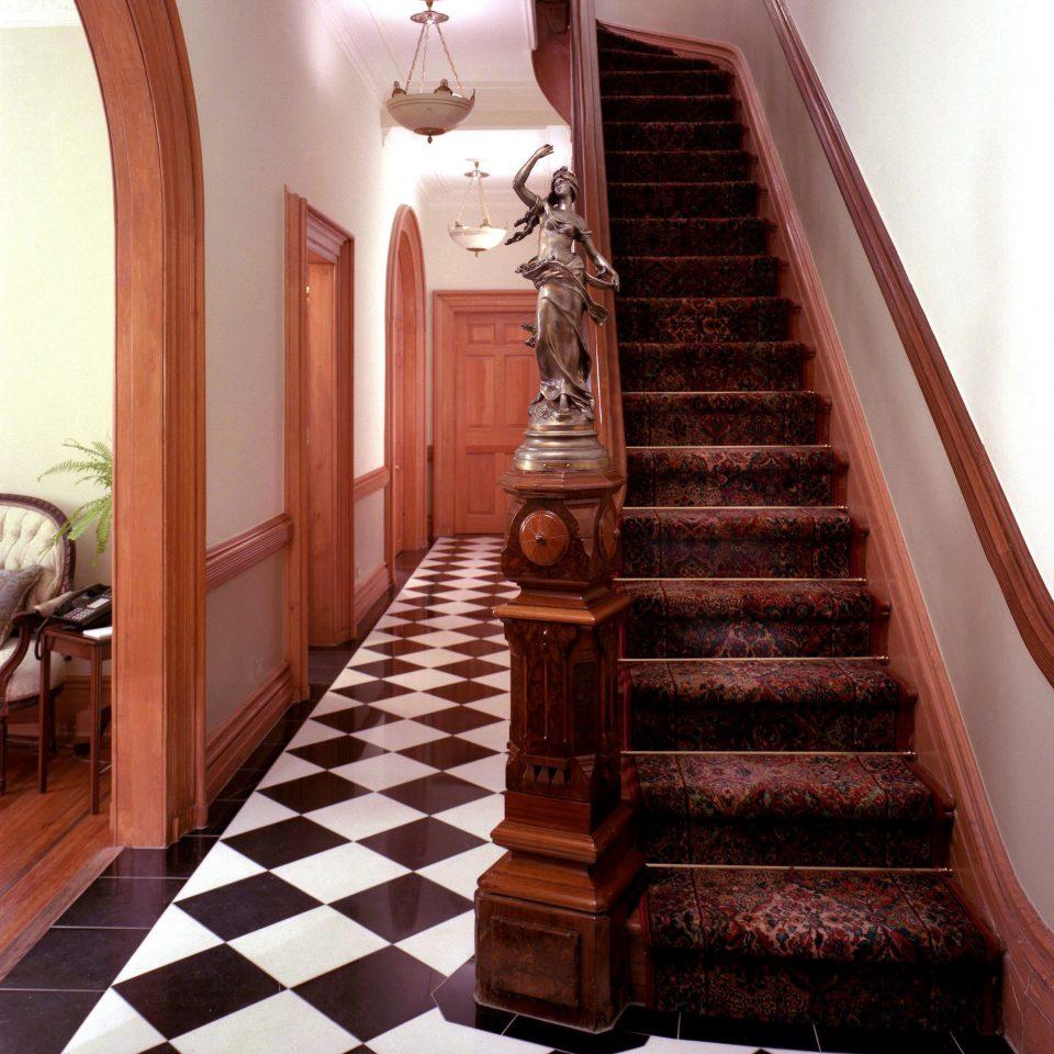 stairs property flooring hardwood wood flooring living room baluster tiled tile step