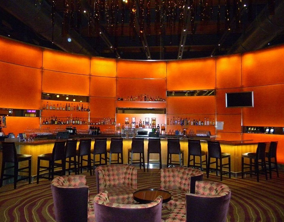 auditorium orange function hall stage convention center conference hall theatre nightclub Bar restaurant
