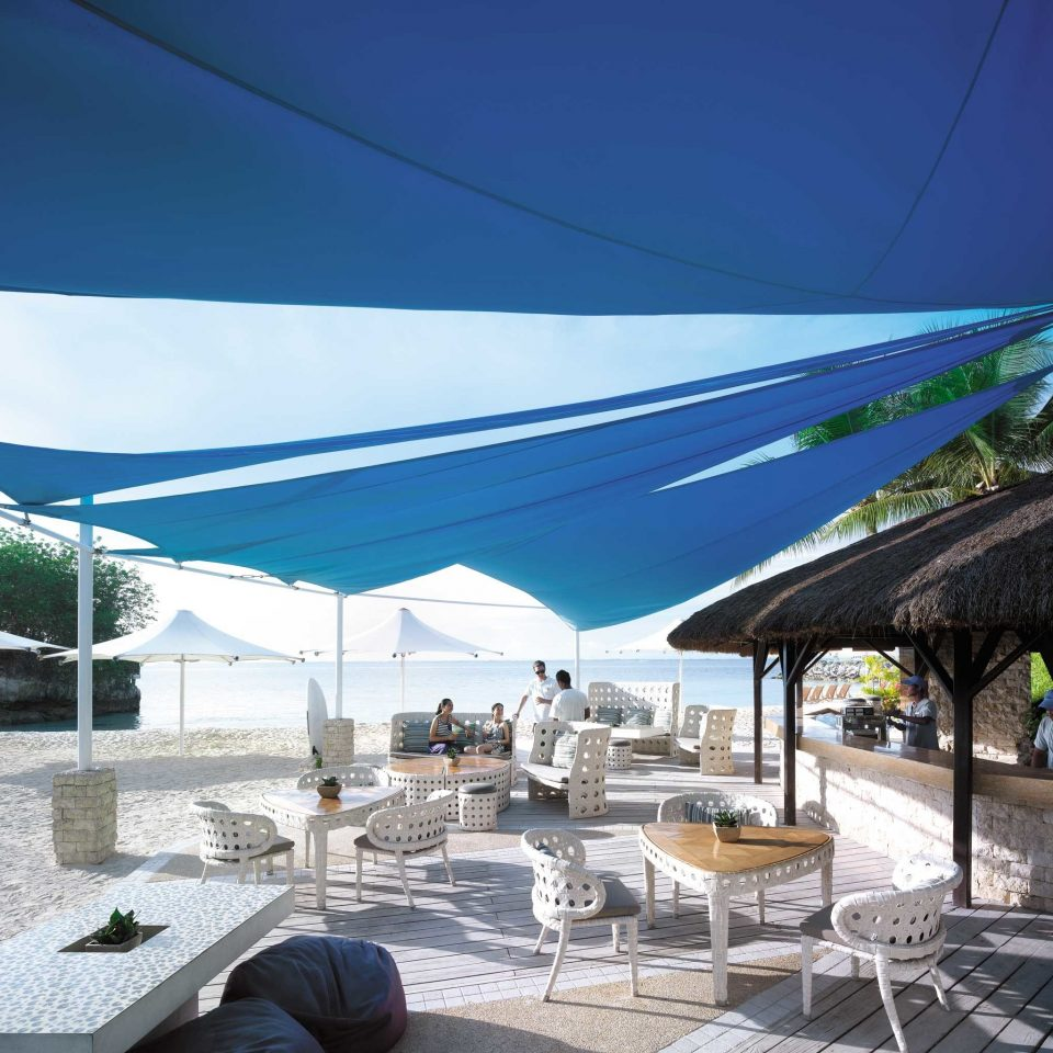 Bar Beach Beachfront Deck Drink Lounge sky ground tent property canopy Resort Villa swimming pool day