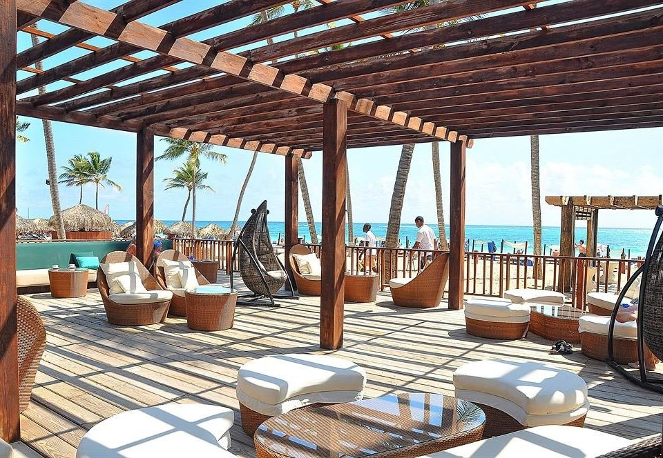 Bar Beach Beachfront Dining Drink Eat Luxury Modern Ocean Romantic chair property Resort building Villa outdoor structure cottage swimming pool overlooking Deck