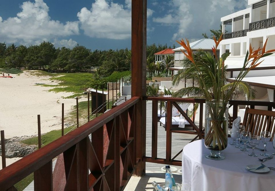 Bar Beachfront Dining Drink Eat Elegant Luxury sky property Resort wooden home Beach condominium walkway restaurant Villa Deck overlooking