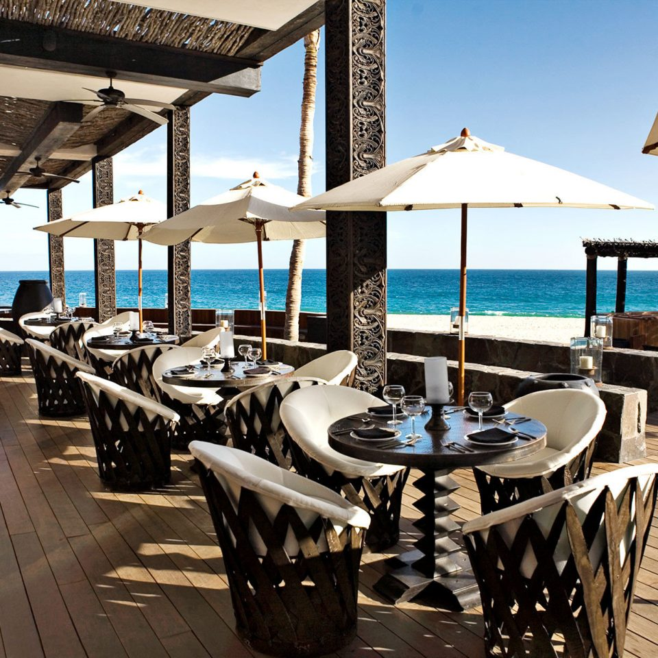 Bar Beach Beachfront Deck Dining Drink Eat chair Resort vehicle dock restaurant marina yacht lined