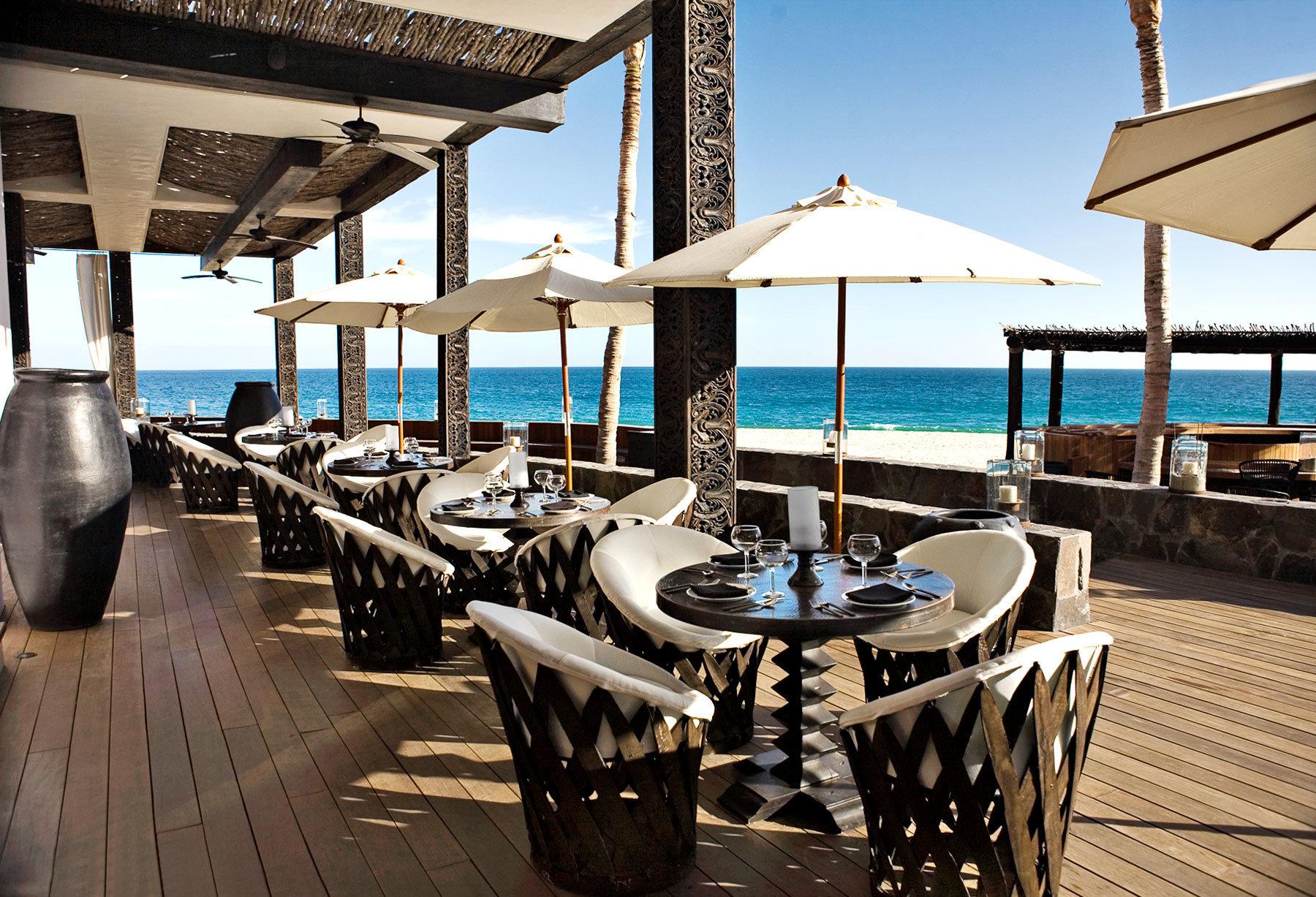 Bar Beach Beachfront Deck Dining Drink Eat chair Resort vehicle dock restaurant marina yacht lined