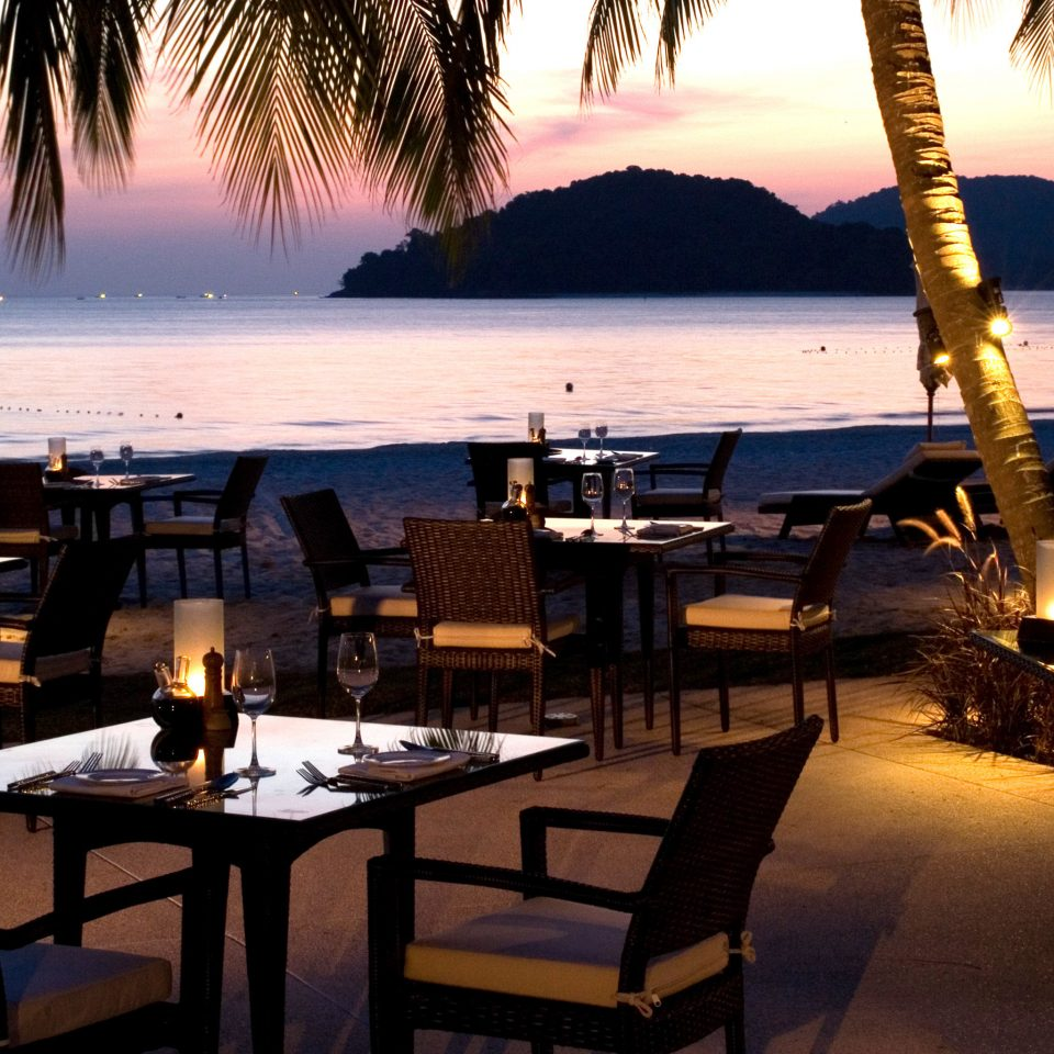 Bar Beach Beachfront Dining Drink Eat Ocean Romantic water restaurant Resort evening tree shore overlooking set
