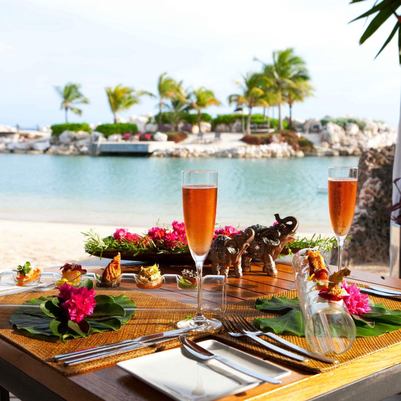 Bar Beach Beachfront Dining Drink Eat Elegant Luxury Ocean Scenic views Resort restaurant Villa set dining table