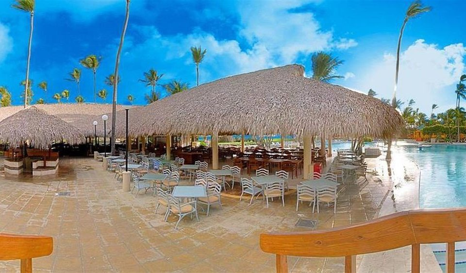Bar Beachfront Dining Drink Eat Hip Luxury Modern chair umbrella sky leisure property Resort Beach swimming pool marina Lagoon lawn dock Water park set day