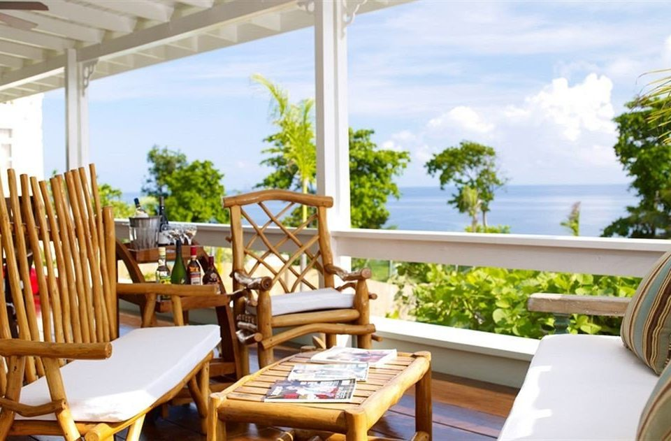 Bar Beach Budget Sea chair property Resort Villa home cottage restaurant condominium Dining caribbean eco hotel dining table