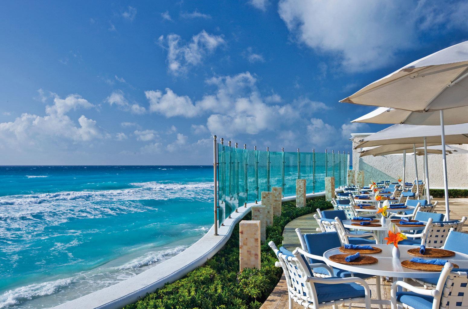 Bar Dining Drink Eat Elegant Hip Luxury Modern sky chair water Sea Ocean Beach caribbean lawn shore horizon Coast vehicle Resort marina Nature dock cape