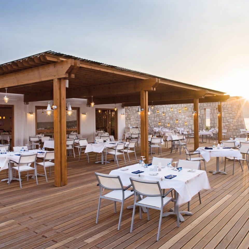 Bar Beach Deck Dining Drink Eat Honeymoon Romance Scenic views Sunset Waterfront sky chair Resort wooden restaurant function hall Villa
