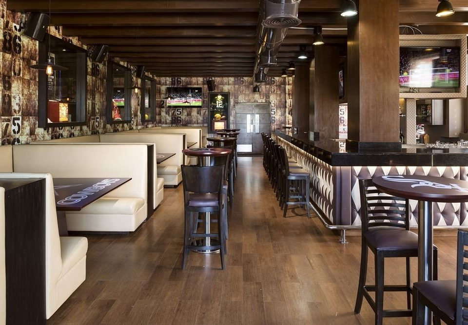 Bar Beach Drink Resort Sea chair property Dining restaurant dining table