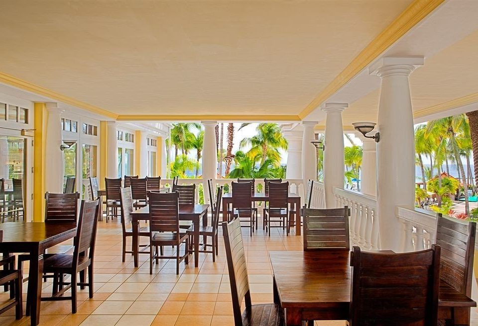 Bar Beach Dining Drink Eat Luxury Romantic Scenic views chair property Resort home Villa condominium hacienda mansion porch dining table