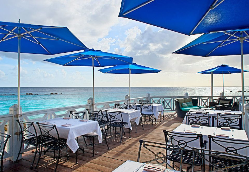 Bar Beach Dining Drink Eat Luxury Romantic Scenic views umbrella sky chair accessory leisure lawn vehicle caribbean restaurant Resort set shore day