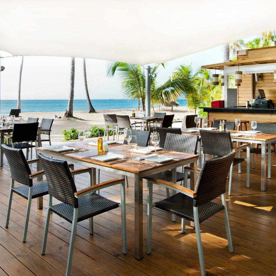 Bar Beachfront Classic Dining Drink Eat Resort Scenic views chair sky property restaurant condominium