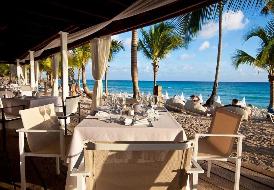 Bar Beachfront Dining Drink Eat Luxury Scenic views chair leisure Resort restaurant palm caribbean Villa Deck Island shade