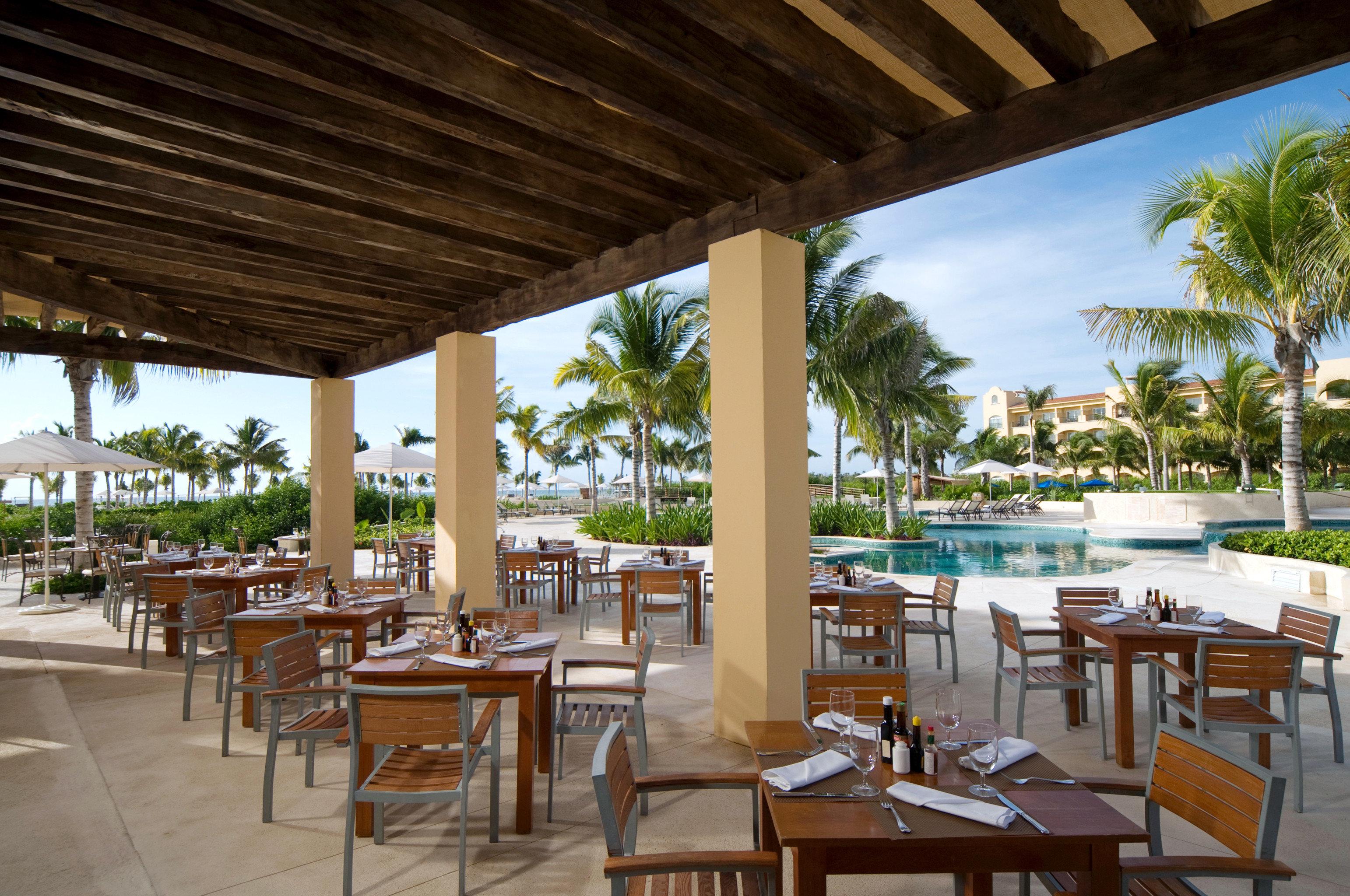 Bar Beachfront Dining Drink Eat Luxury chair building property Resort restaurant porch Villa Deck