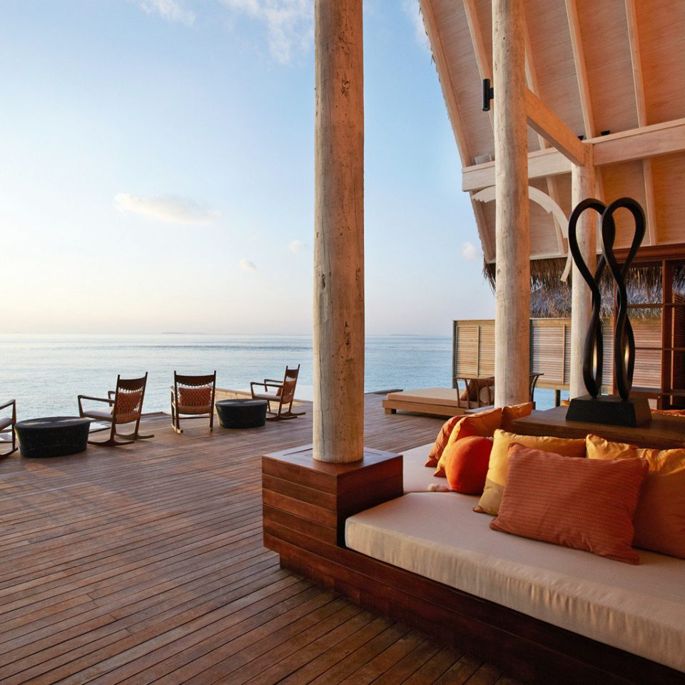 Bar Beachfront Deck Dining Drink Eat Lounge Waterfront property Resort Villa cottage living room