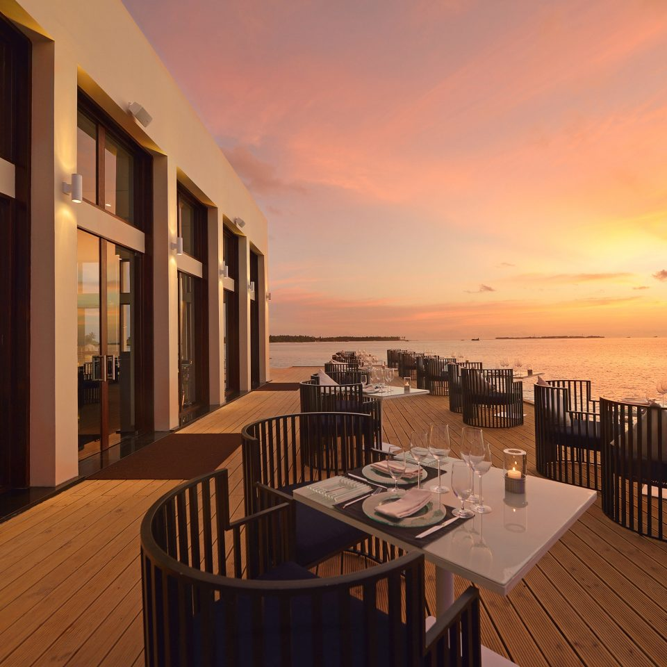Bar Beachfront Deck Dining Drink Eat Waterfront sky scene evening Sunset Resort overlooking