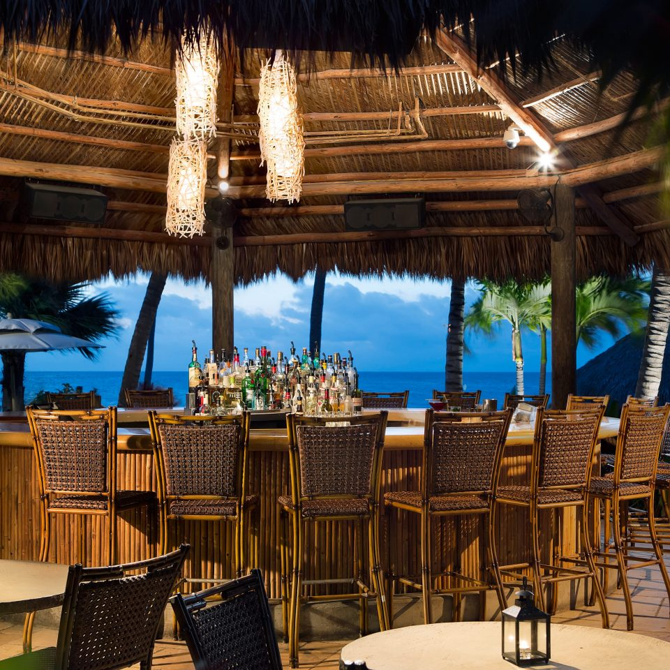 Bar Beachfront Dining Drink Eat Island Lodge Ocean Tropical chair Resort restaurant palace